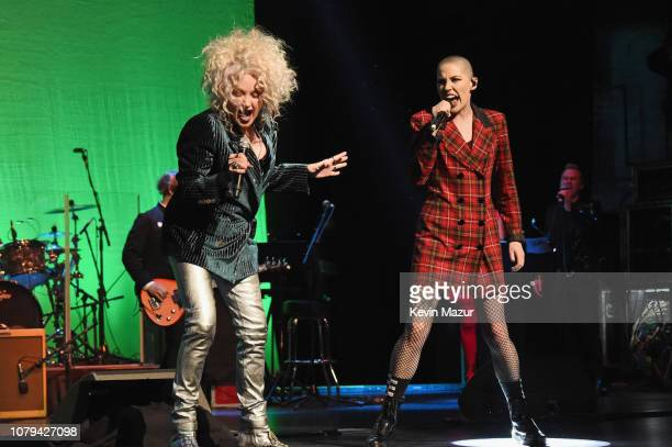Cyndi Lauper and Bishop Briggs perform onstage during Cyndi Lauper's 8th Annual 'Home For The Holidays' Benefit Concert at Beacon Theatre on December...