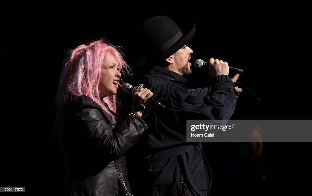 Cyndi Lauper and Boy George perform at the 5th Annual 'Cyndi Lauper and Friends: Home For The Holidays' benefit concert at The Beacon Theatre on December 5, 2015 in New York City.