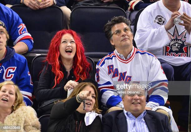 Cyndi Lauper and David Thornton attend the Philadelphia Flyers vs New York Rangers playoff game at Madison Square Garden on April 17 2014 in New York...