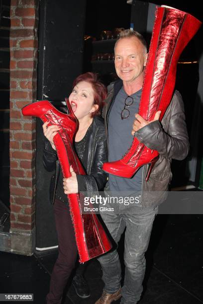 Cyndi Lauper and Sting pose backstage at the hit musical 'Kinky Boots' on Broadway at The Al Hirshfeld Theater on April 27 2013 in New York City