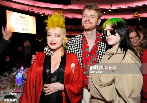 Cyndi Lauper Finneas O'Connell and Billie Eilish are seen with FIJI Water and JNSQ at Billboard's Women In Music 2019 on December 12 2019 in Los...