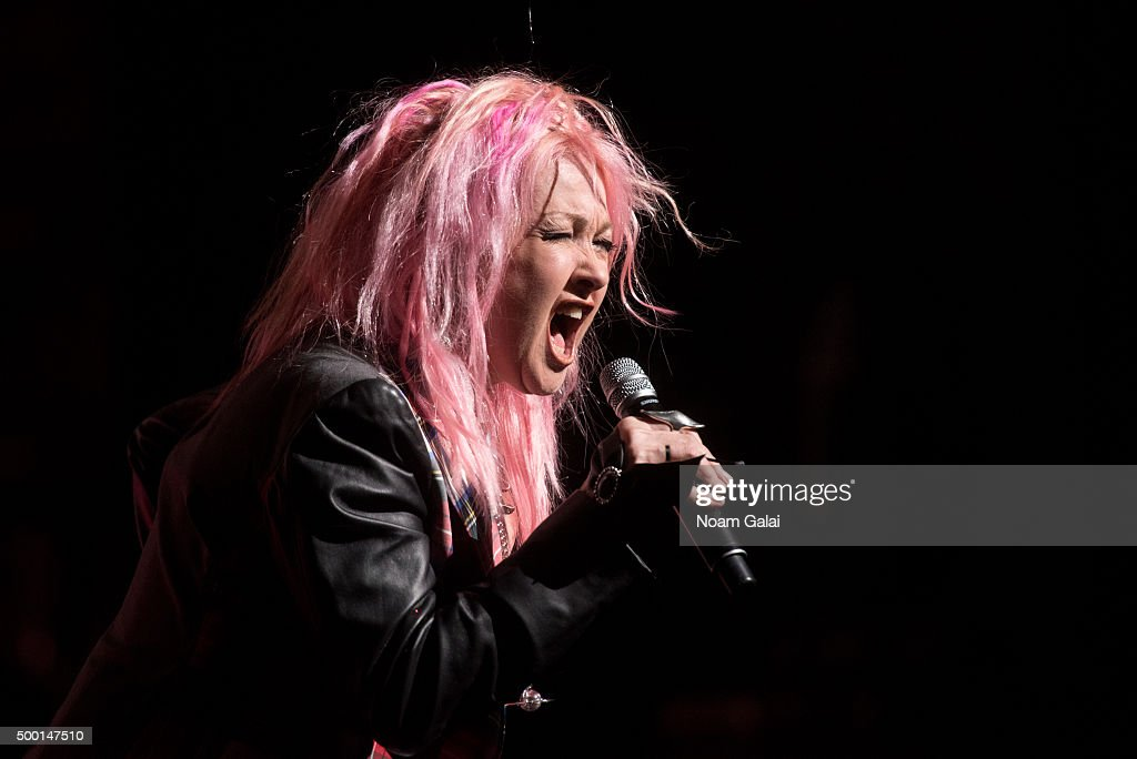 Cyndi Lauper performs at the 5th Annual 'Cyndi Lauper and Friends: Home For The Holidays' benefit concert at The Beacon Theatre on December 5, 2015 in New York City.