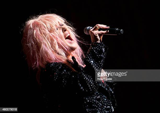 Cyndi Lauper performs during the 4th Annual 'Home For The Holidays' Benefit Concert at Beacon Theatre on December 6 2014 in New York City