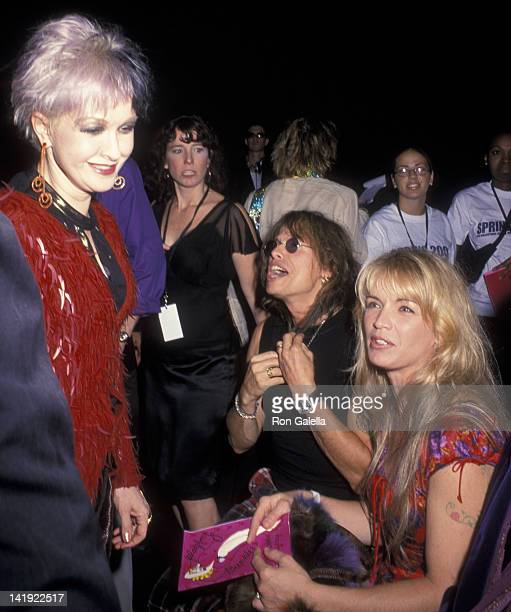 Cyndi Lauper Steven Tyler and wife Teresa Barrick attend Betsey Johnson Spring Collection Fashion Show on September 19 2000 at Bryant Park in New...