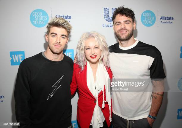 Cyndi Lauper with Alex Pall and Andrew Taggart of The Chainsmokers attend WE Day California at The Forum on April 19 2018 in Inglewood California