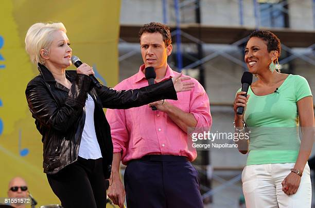 Cyndi Lauper with cohosts Robin Roberts and Chris Cuomo on ABC's Good Morning America on June 13 2008 in Bryant Park in New York City