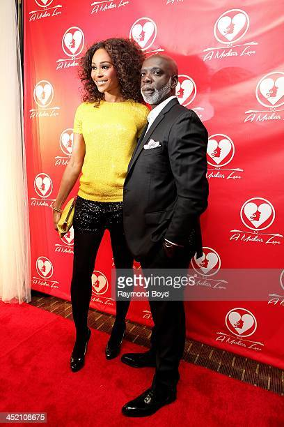 Cynthia Bailey and husband Peter Thomas from Bravo's Real Housewives Of Atlanta poses for red carpet photos for A Mother's Love stage play at the...