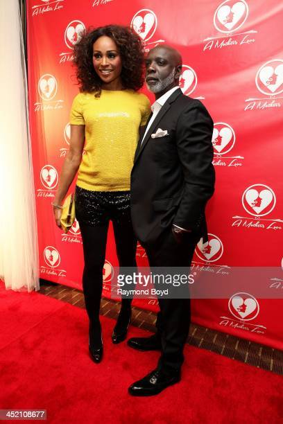 """Cynthia Bailey and husband Peter Thomas from Bravo's """"Real Housewives Of Atlanta"""" poses for red carpet photos for """"A Mother's Love"""" stage play at the..."""