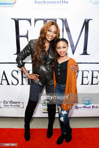 Cynthia Bailey and Paris Moore attend FTM Fashion Week S7 at Sturgeon City on November 23 2019 in Jacksonville North Carolina