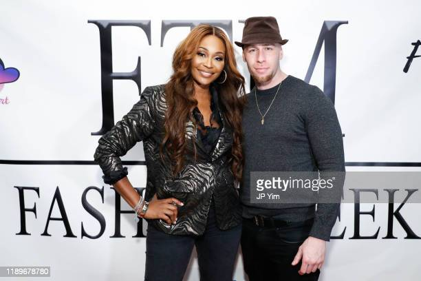 Cynthia Bailey and Sergio Delavicci attend FTM Fashion Week S7 at Sturgeon City on November 23 2019 in Jacksonville North Carolina