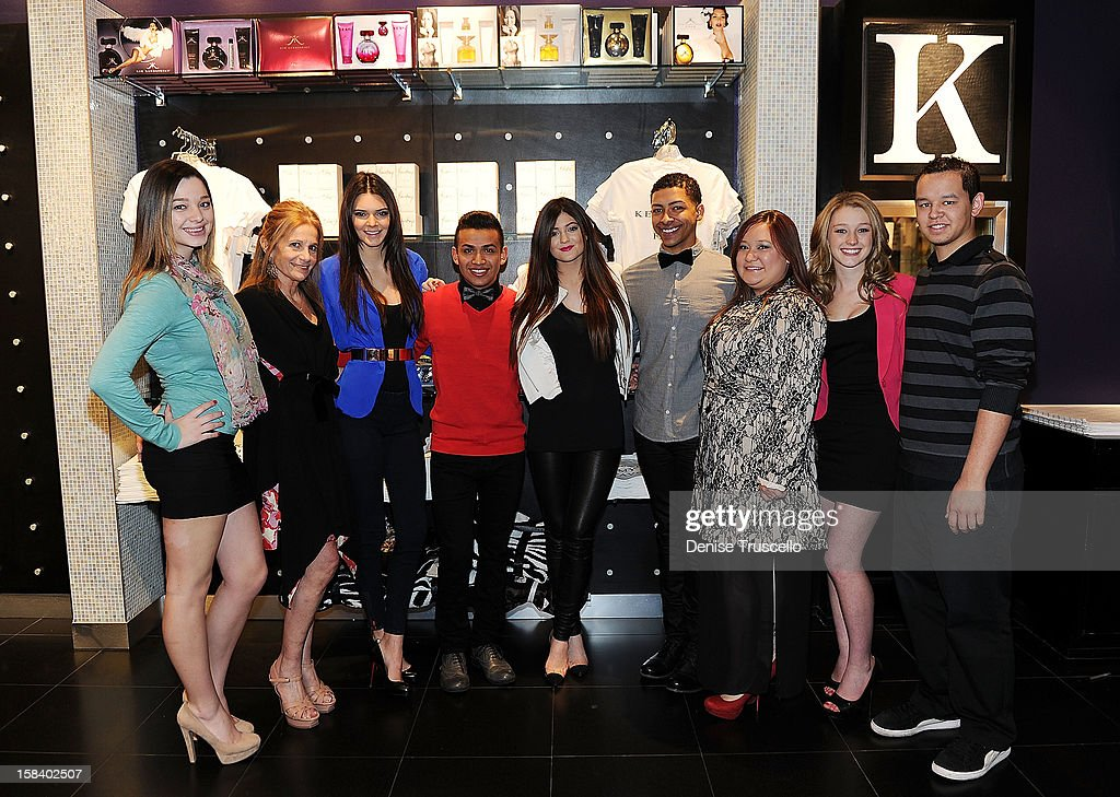 Cynthia Bussey, (2nd from L), Kendall Jenner (3rd from L) and Kylie Jenner (C) poses for photos with the Kardashian Khaos team store at The Mirage Hotel and Casino on December 15, 2012 in Las Vegas, Nevada.