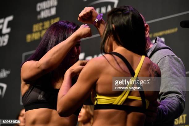 Cynthia Calvillo and Carla Esparza face off during the UFC 219 weighin inside TMobile Arena on December 29 2017 in Las Vegas Nevada