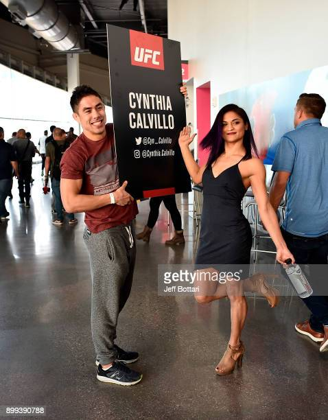 Cynthia Calvillo and coach Justin Buchholz pose for a photo during the UFC 219 Ultimate Media Day inside TMobile Arena on December 28 2017 in Las...