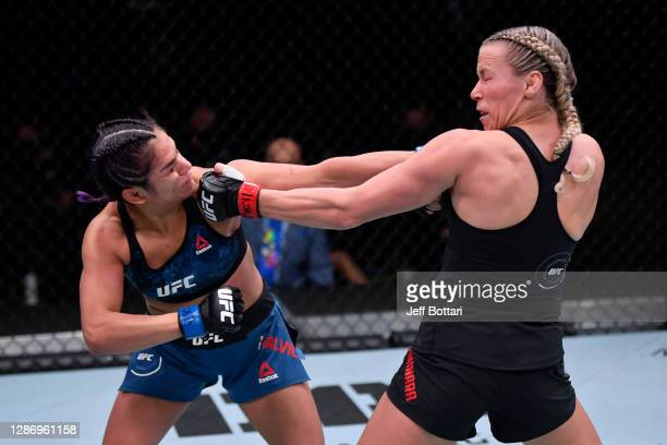 Cynthia Calvillo and Katlyn Chookagian exchange punches in their women's flyweight bout during the UFC 255 event at UFC APEX on November 21, 2020 in...