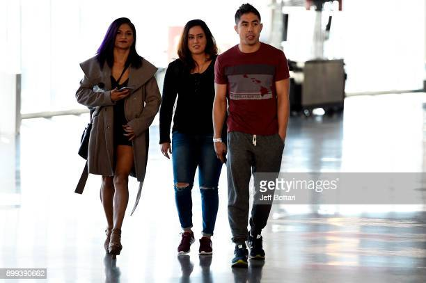 Cynthia Calvillo arrives with coach Justin Buchholz during the UFC 219 Ultimate Media Day inside TMobile Arena on December 28 2017 in Las Vegas Nevada