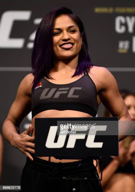 Cynthia Calvillo poses on the scale during the UFC 219 weighin inside TMobile Arena on December 29 2017 in Las Vegas Nevada