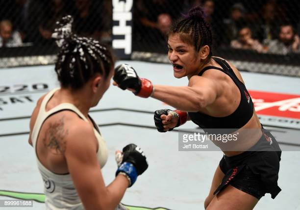 Cynthia Calvillo punches Carla Esparza in their women's strawweight bout during the UFC 219 event inside TMobile Arena on December 30 2017 in Las...
