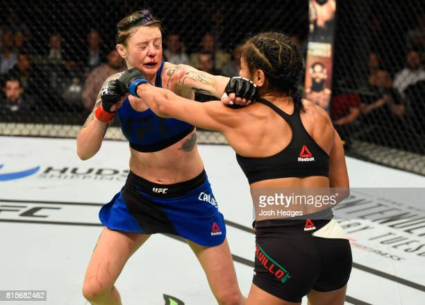 Cynthia Calvillo punches Joanne Calderwood of Scotland in their women's strawweight bout during the UFC Fight Night event at the SSE Hydro Arena...