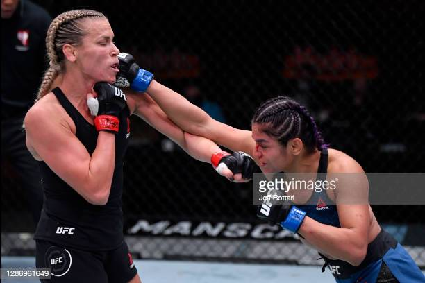 Cynthia Calvillo punches Katlyn Chookagian in their women's flyweight bout during the UFC 255 event at UFC APEX on November 21, 2020 in Las Vegas,...