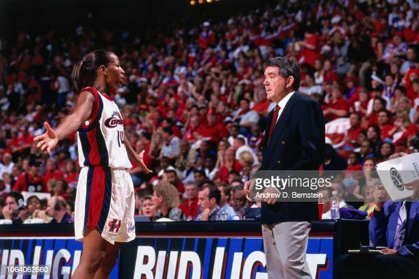 Cynthia Cooper and Van Chancellor of the Houston Comets celebrates during Game Three of the 1998 WNBA Finals on September 1 1998 at the Compaq Center...