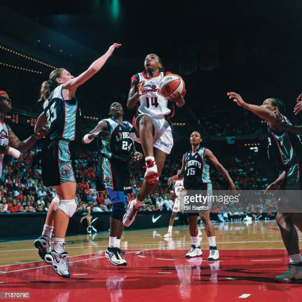 Cynthia Cooper of the Houston Comets attempts a layup against the New York Liberty during Game Two of the 2000 WNBA Finals played August 26 2000 at...