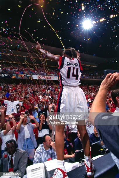 Cynthia Cooper of the Houston Comets celebratesb during Game Three of the 1998 WNBA Finals on September 1 1998 at the Compaq Center in Houston Texas...
