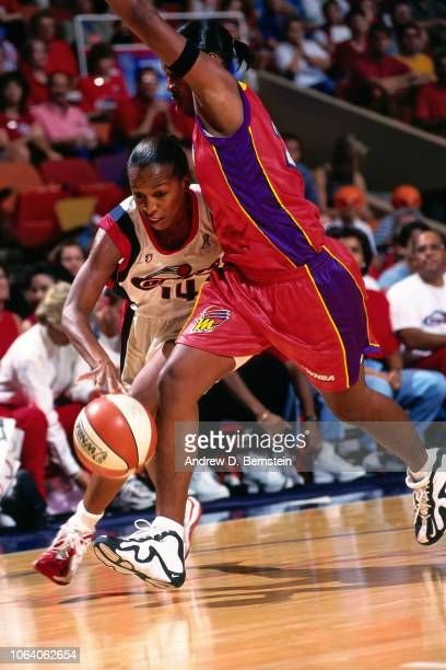 Cynthia Cooper of the Houston Comets dribbles during Game Three of the 1998 WNBA Finals on September 1 1998 at the Compaq Center in Houston Texas...