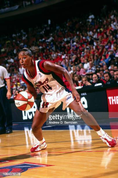 Cynthia Cooper of the Houston Comets dribbles during Game Two of the 1998 WNBA Finals on August 29 1998 at the Compaq Center in Houston Texas NOTE TO...
