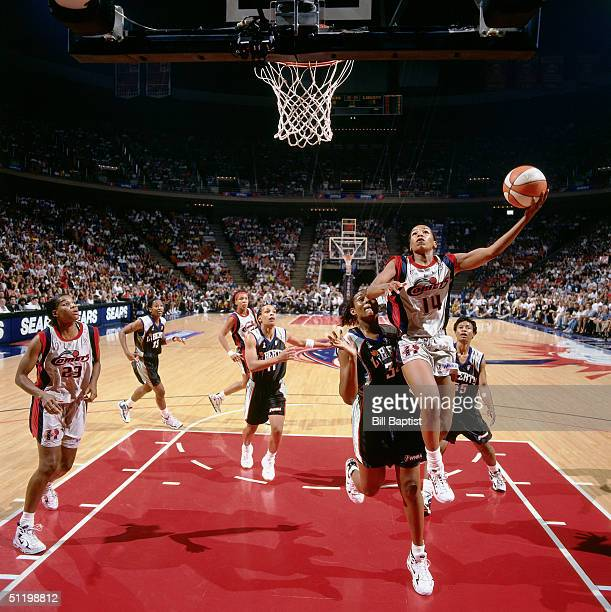 Cynthia Cooper of the Houston Comets drives to the basket against the New York Liberty during a WNBA game at Compaq Center in 1997 in Houston Texas...