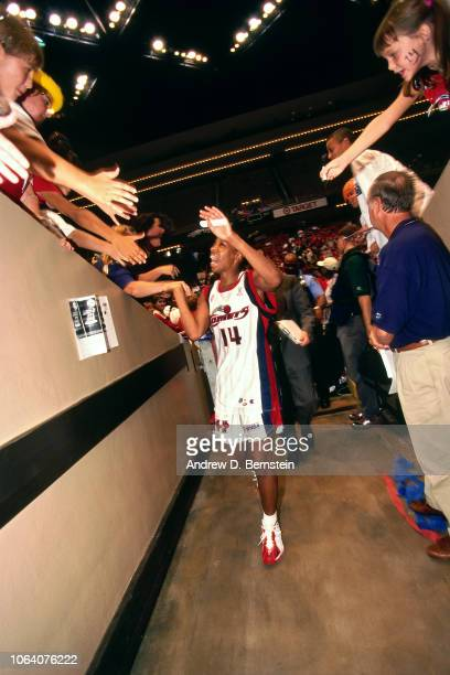 Cynthia Cooper of the Houston Comets greets the fans during Game Two of the 1998 WNBA Finals on August 29 1998 at the Compaq Center in Houston Texas...
