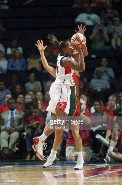 Cynthia Cooper of the Houston Comets shoots against the Seattle Storm during the game on May 22 2003 at Compaq Center in Houston Texas The Comets won...