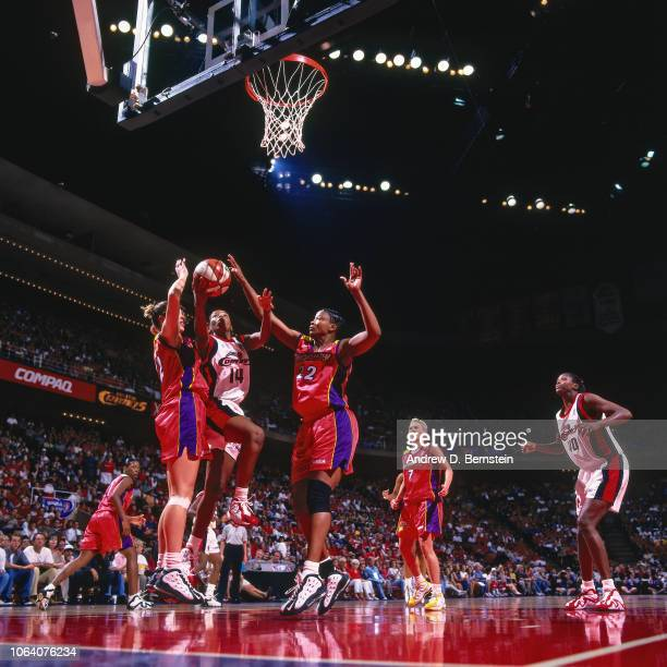 Cynthia Cooper of the Houston Comets shoots during Game Two of the 1998 WNBA Finals on August 29 1998 at the Compaq Center in Houston Texas NOTE TO...
