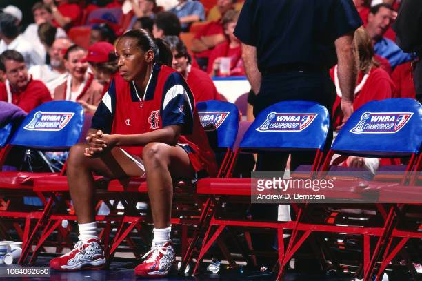 Cynthia Cooper of the Houston Comets sits on the bench during Game Three of the 1998 WNBA Finals on September 1 1998 at the Compaq Center in Houston...