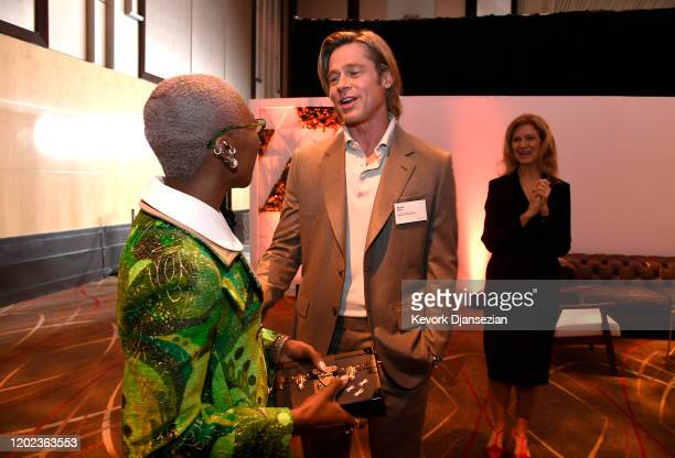 Cynthia Erivo and Brad Pitt attend the 92nd Oscars Nominees Luncheon on January 27 2020 in Hollywood California