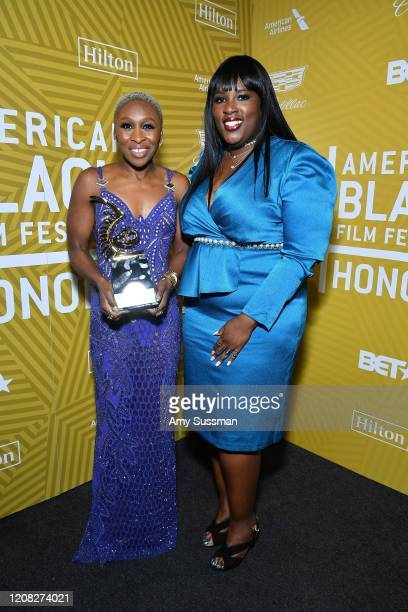 Cynthia Erivo and Director Multicultural Diversity Relations of Hilton Andrea Richardson pose with the Rising Star Award backstage during the...