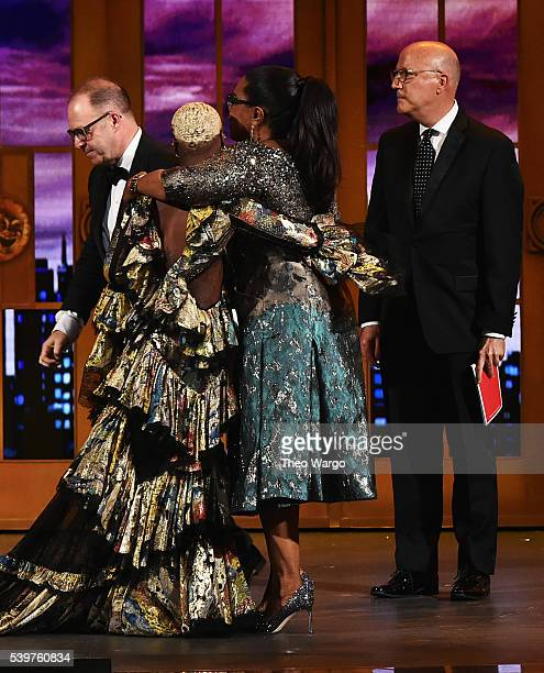 Cynthia Erivo and Oprah Winfrey hug while onstage for Best Revival of a Musical for 'The Color Purple' during the 70th Annual Tony Awards at The...