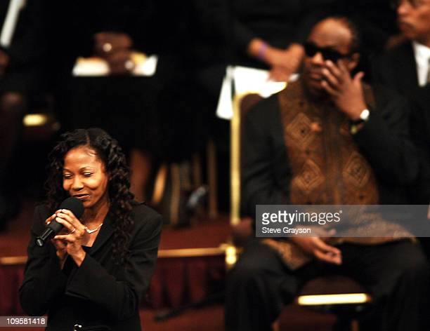 Cynthia Felton sings during the funeral service for the late Johnnie Cochran as Stevie Wonder wipes away a tear from his eye at the West Angeles...