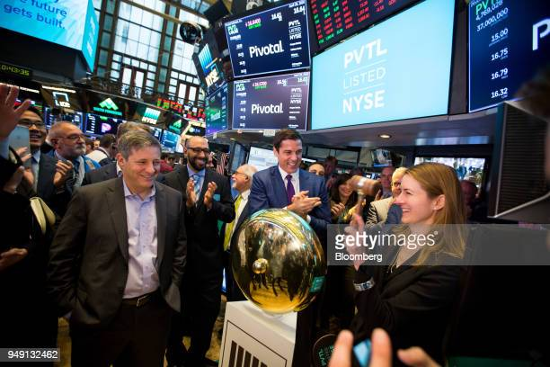 Cynthia Gaylor chief financial officer of Pivotal Software Inc right rings a ceremonial bell with Rob Mee chief executive officer of Pivotal Software...