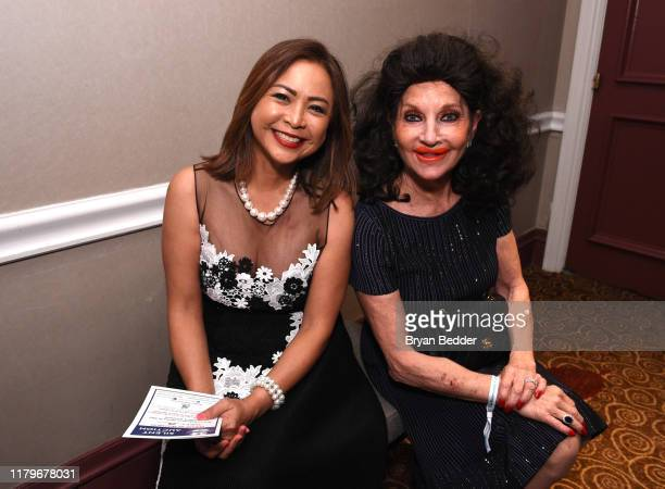 Cynthia Halelamien and Christine Lynn attend the Legends Reception during the 34th Annual Great Sports Legends Dinner To Benefit The Buoniconti Fund...