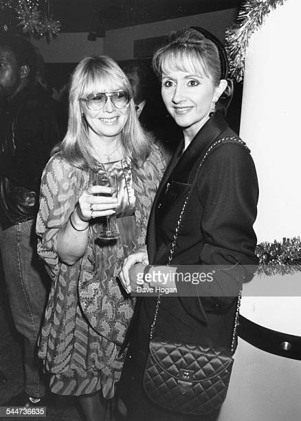 Cynthia Lennon former wife of musician John Lennon with author Sally Burton at the opening of her wine bar in London December 15th 1988