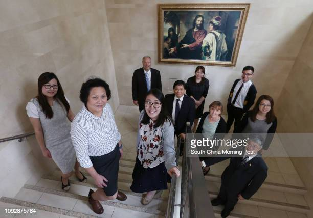 Cynthia Li Audrey Yan and Emily Chan Elder Lynn Beckstead Kenny Fong Kristen Tsui Sister Karen Beckstead Chris Ng Flora Ho and Ted Yan pose for a...
