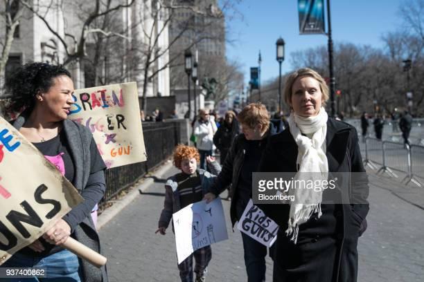 Cynthia Nixon, actress and 2018 New York gubernatorial Democratic candidate, right, walks on Central Park West ahead of the March For Our Lives in...
