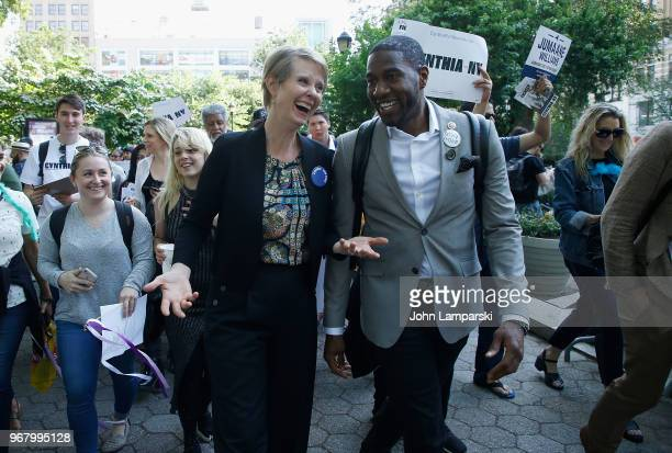 Cynthia Nixon and Jumaane Williams walk during the petitioning parade for New York State Governor at Union Square Park on June 5 2018 in New York City