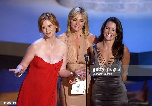 Cynthia Nixon Kim Cattrall and Kristin Davis from 'Sex and the City' present the Best Actor in a Drama Series at the 54th Annual Emmy Awards