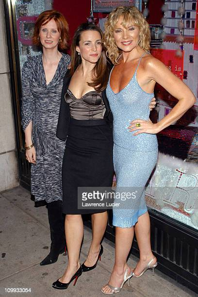 Cynthia Nixon Kristin Davis and Kim Cattrall during Barneys'New York Holiday Windows 2003 Fairytales and the City at Barneys New York in New York...