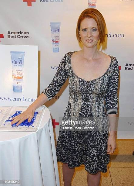 Cynthia Nixon lends her helping hand to the Curel Skin Care helping hands wall benefiting the American Red Cross at the Time Warner Center on...