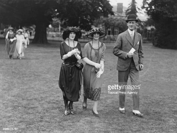 Cynthia Noble with Peggy Lewis and Mr Priesworth at a polo pony show at the Ranelagh Club in Barnes West London June 1921