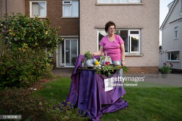 Cynthia Osborne poses with an Easter table display which she would normally exhibit in her local church but has decided to display in her front...