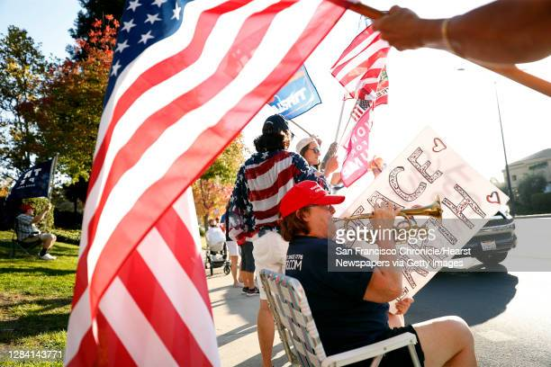 """Cynthia Pierce of Martinez plays the trumpet while joining fellow supporters of US president Donald Trump taking part in a """"Trump Town USA Rally"""" at..."""