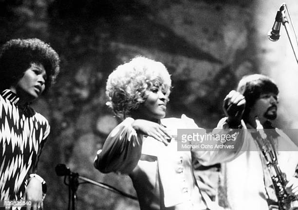Cynthia Robinson Rose Stone and Jerry Martini of the psychedelic soul group 'Sly And The Family Stone' performs onstage in circa 1973